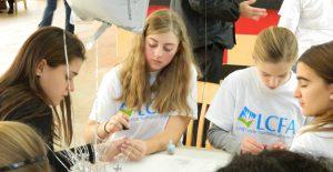 Photo of volunteers polishing nails