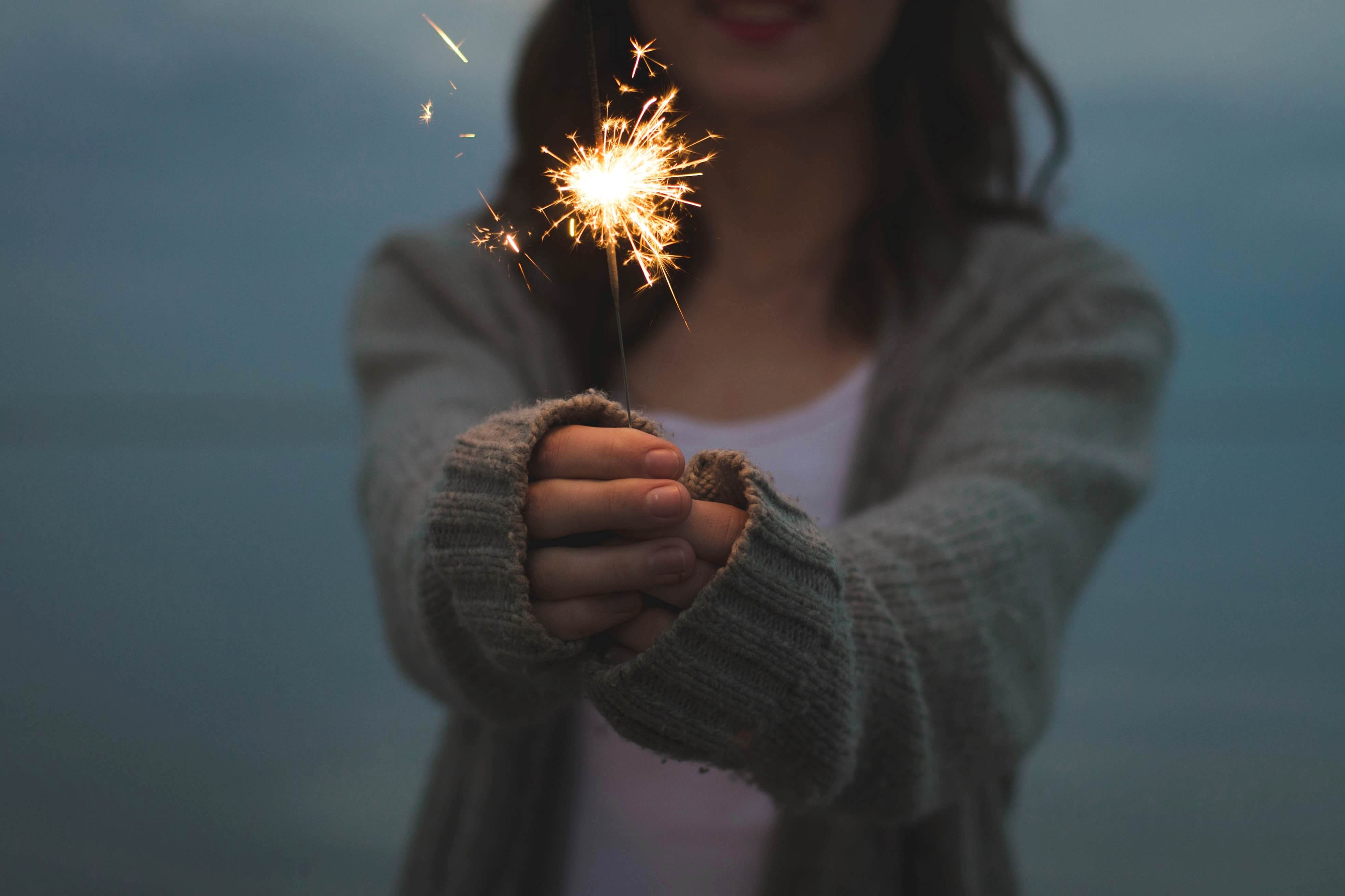 Sparklers and hands