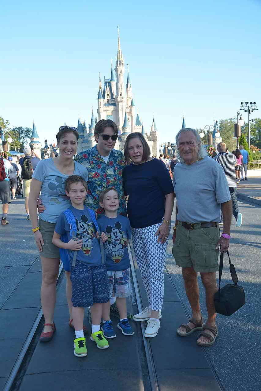 Laura and her family in front of Sleeping Beauty Castle